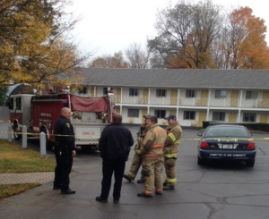 Police and fire personnel at The Towne Motel on Tuesday following a report that a grenade had been found lodged between the building and an oil tank.