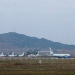 The Associated Press What appears to be a United States Air Force passenger jet, right, is parked on the tarmac of Sunan International Airport in Pyongyang, North Korea.