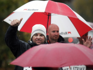 FairPoint Communications workers greet supporters while picketing Tuesday in the rain at the company's office in Augusta. The phone technicians and clerks are committed to picketing all week despite a forecast for heavy rain , according to Luke Bean, a union member who is out on strike.