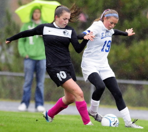 Lincoln Academy forward Leslie Sandefur, left, and Erskine Academy midfielder Avery Bond battle for a ball during a game Tuesday in South China. Erskine won 3-1.