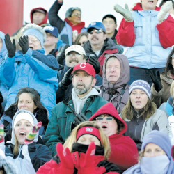 Cony High School fans cheer their football team during the 2007 showdown with Gardiner in Augusta.