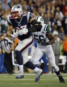 New England Patriots tight end Rob Gronkowski (87) runs from New York Jets inside linebacker Demario Davis (56) after catching a pass during the second half last week in Foxborough, Mass. The Patriots play the Chicago Bears on Sunday.