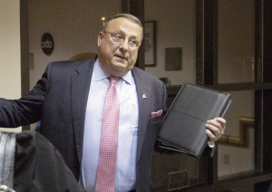 Press Herald photo by Gabe Souza   Gov. Paul LePage stops in the lobby of WMTW television in Auburn, on Tuesday, following the last of six gubernatorial debates.