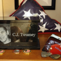 An urn containing the ashes of C.J. Twomey sits on a shelf at his parent's home in Auburn in December. A vial of his ashes was aboard a rocket launched from the New Mexican desert into space before landing in the White Sands Missile Range on Thursday.