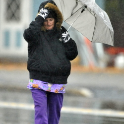 Priscilla Campbell walks home in the cold rain on College Avenue in Waterville on Wednesday.