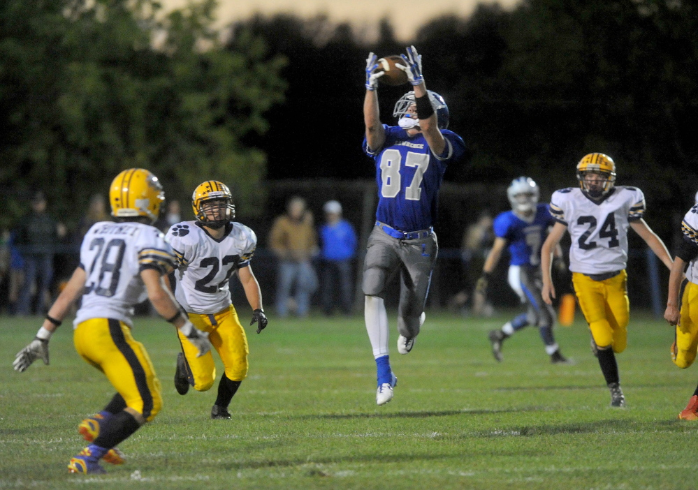 Staff file photo by Michael G. Seamans   Lawrence High School receiver Seth Powers hauls in a pass during a game against Mt. Blue earlier this season. Powers the Bulldogs welcome Messalonskee to Keyes Field this week.