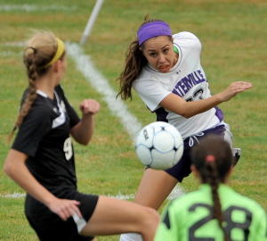 Waterville Senior High School's Pilar Elias, right, battles for control of the ball during a game against Maranacook this season. Elias has a team-high 32 goals this fall.
