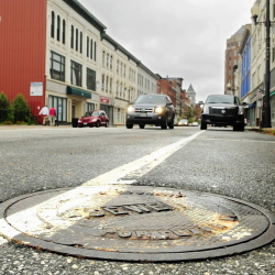 Storm grates and manhole covers like this one on Water Street in Augusta on Friday have been stolen recently.