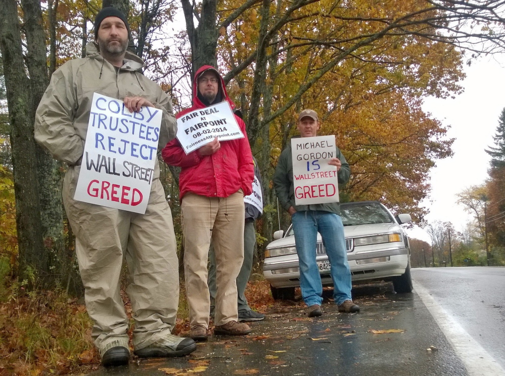 Striking FairPoint employee Lee Pettengill is joined by two other picketers as electrical workers union members picketed a meeting of the Colby College trustees Friday in Waterville. A member of the Colby board, Michael Gordon, is chief investment officer for a hedge fund that the union said owns a large stake in FairPoint.