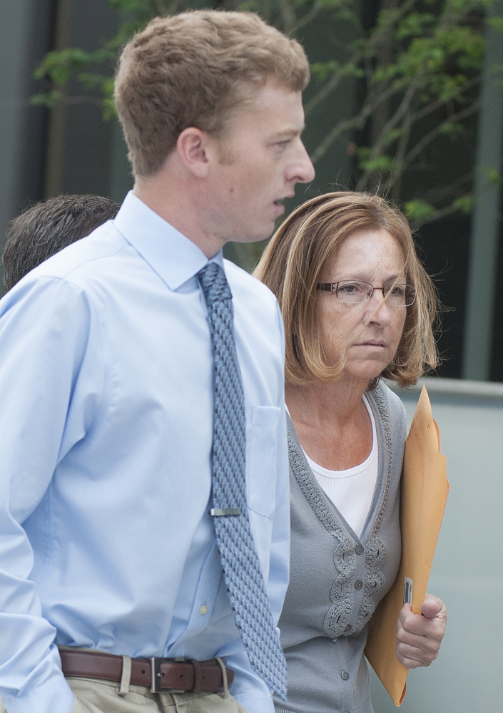 Carole Swan, former Chelsea selectwoman, with her son John Swan, enter the U.S. District Court building in Bangor on June 13 for her sentencing hearing on extortion, tax fraud and workers compensation fraud.