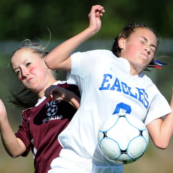 Erskine Academy's Lauren Wood, 6, battles for the ball with Maine Central Institute's Page Lord, 16, at Erskine Academy in south China on Saturday.