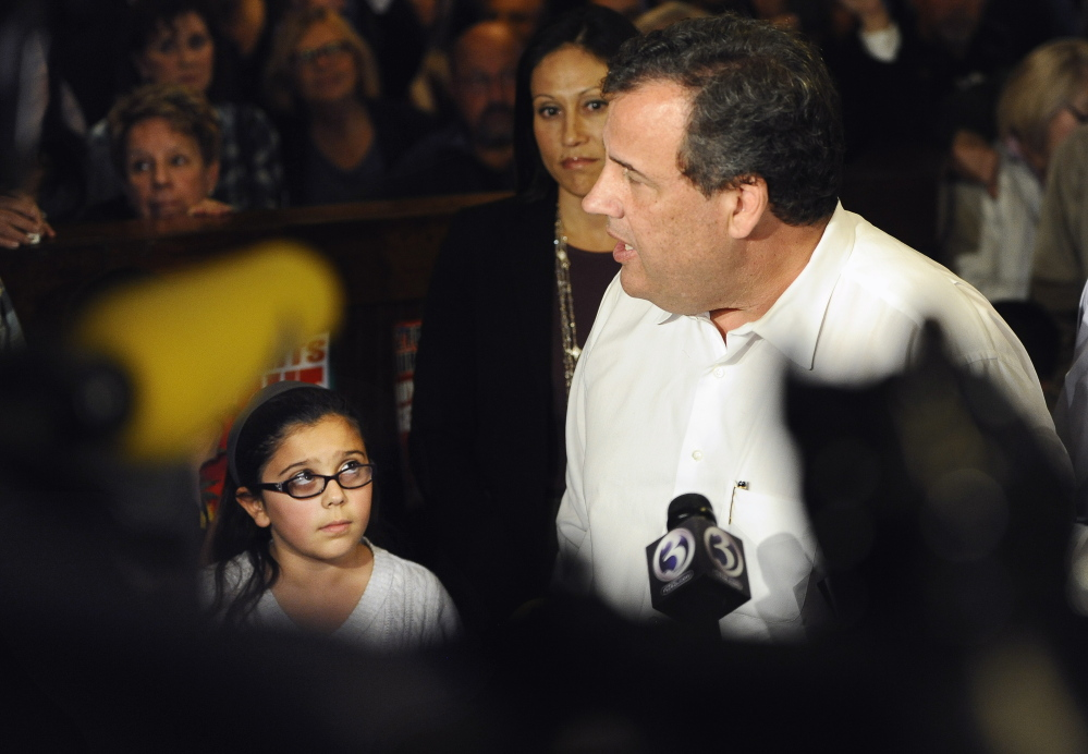 New Jersey Gov. Chris Christie answers questions from the media about nurse Kaci Hickox's quarantine at a rally for Republican candidate for Connecticut governor Tom Foley, Monday, Oct. 27, 2014, in Groton, Conn. (AP Photo/Jessica Hill)