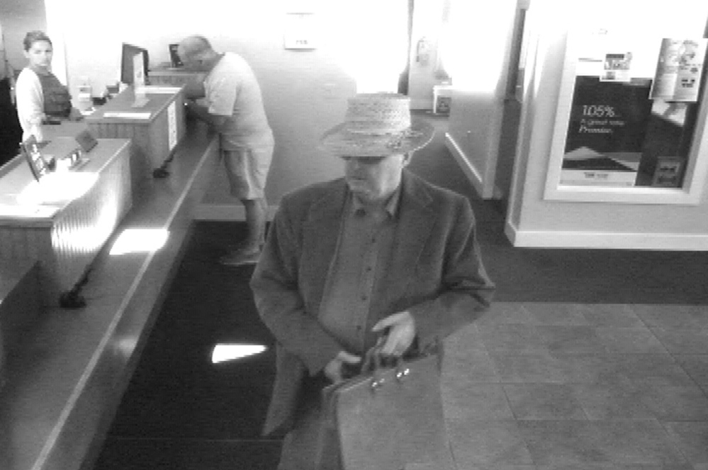 This surveillance photo shows the robbery in progress June 23 at the Bank of Maine Hallowell branch. John Cecil Slater, 66, pleaded guilty Tuesday to the robbery.