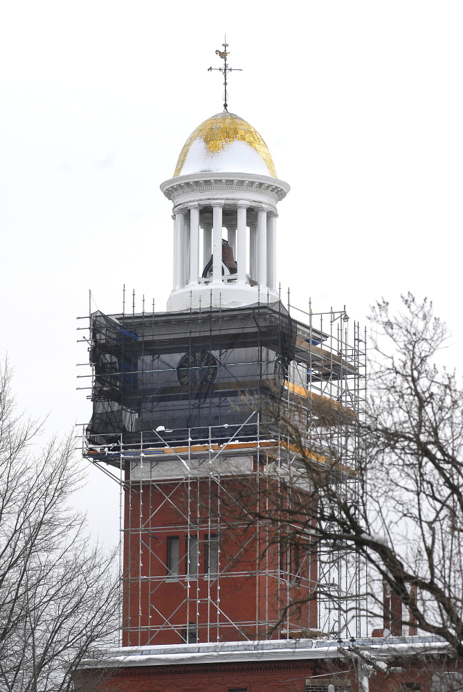 """The Biddeford City Hall clock tower, surrounded by scaffolding in 2009, is now named on Maine Preservation's """"Most Endangered Properties"""" list."""