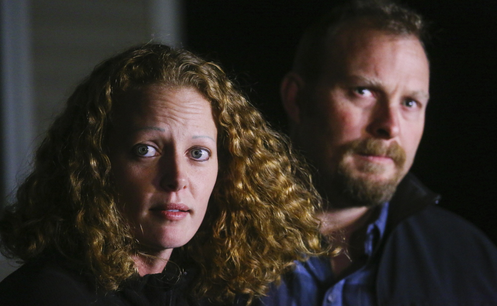 "Nurse Kaci Hickox and boyfriend Ted Wilbur answer media questions on the state's quarantine policy Wednesday evening outside Wilbur's home in Fort Kent. Hickox said she still has no symptoms of Ebola and ""I remain in good spirits and I'm thankful to be home."""
