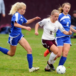Sacopee Valley's Olivia Ruhlin, left, and Brittany Ryan try to stop shot by Monmouth Academy's Haley Fletcher, center, during a Western C quarterfinal game Wednesday. The second-seeded Mustangs fell 2-1.