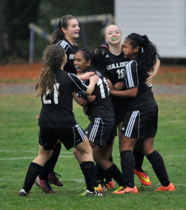 Members of the Hall-Dale girls soccer team celebrate after they upset top-seeded Madison 2-1 in overtime in a Western C quarterfinal round game Wednesday afternoon. Next up for the Bulldogs: A trip to Readfield for a showdown with Maranacook on Friday.