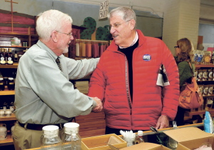 Jim Nicholson, left, shakes hands with gubernatorial candidate Eliot Cutler who was meeting with voters in Waterville on Thursday.