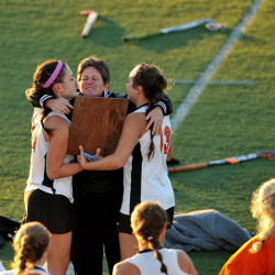 Winslow High School head coach Mary Beth Bourgoin embraces Brooke Haskell, left and Alyssa Wood, after defeating Dexter High School 2-0 Thursday in the Eastern Class C championship game at Hampden Academy.