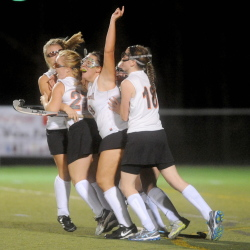 The Gardiner Area High School field hockey team celebrates its 1-0 win over Belfast for the Eastern Maine Class B title Thursday at Hampden Academy. Gardiner defeated Belfast for the Eastern Class B title 1-0 in overtime.