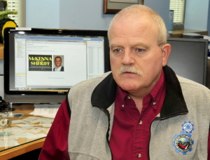 Somerset County IT Director Peter Smith on Wednesday, speaks about the email spam that county officials received regarding Somerset Sheriff candidate Kris McKenna whose image, on computer screen, appeared Monday. Smith said the spam message cost the county money and time.