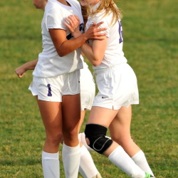Waterville Senior High School's Mackenzie St. Pierre (1) celebrates with Sarah Shoulta (15) after Shoulta's goal against Camden Hills High School in the first half of an Eastern Maine Class B semifinal game Friday at Webber Field in Waterville. Waterville defeated Camden Hills 4-1.