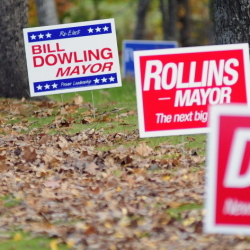 Signs for the two of the candidates for mayor are seen along Townsend Road on Friday in Augusta.