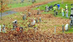 CAP.cutline_standalone:City workers blow leaves into piles that will be vacuumed up by truck on Wednesday in Forest Grove Cemetery in Augusta.