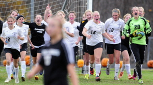 The Marancook Black Bears celebrate after beating Hall-Dale 2-0 in a Western Class C semifinal game Friday at the Ricky Gibson Field of Dreams in Readfield.