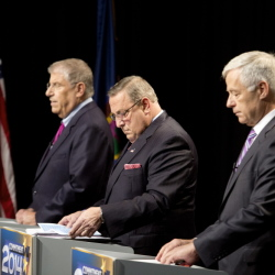 The three candidates for governor, from left independent Eliot Cutler, Republican Gov. Paul LePage and Democratic U.S. Rep. Mike Michaud, look over their notes as they prepare for Tuesday night's debate at WMTW-TV's studio in Auburn Gabe Souza/Staff Photographer
