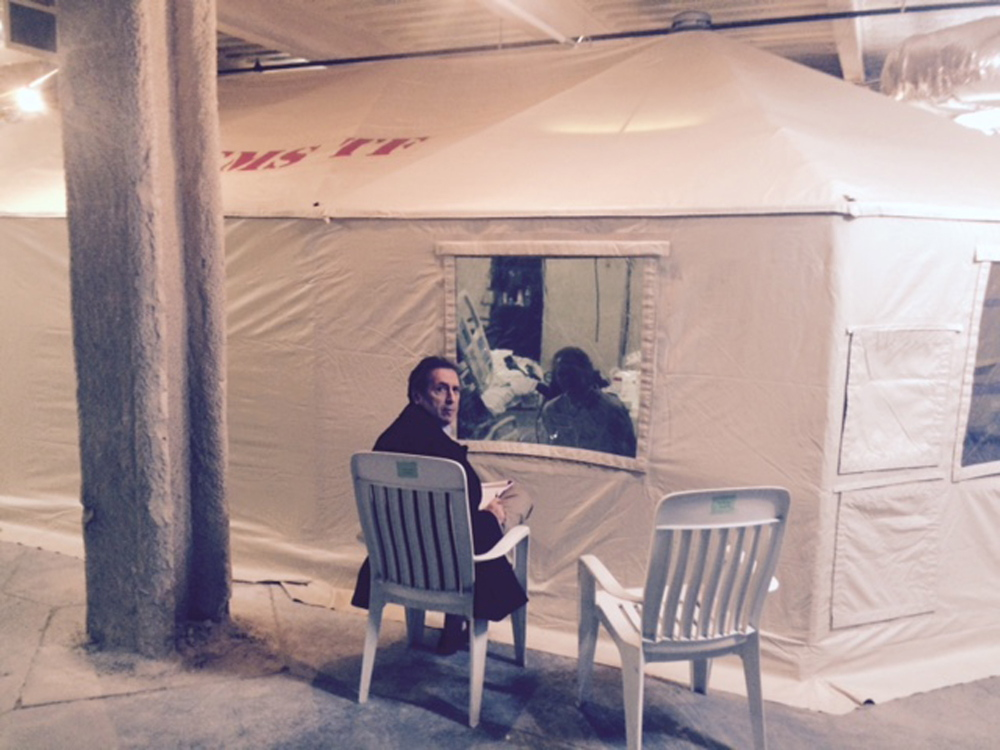 """In this Sunday, Oct. 26, 2014 photo provided by attorney Steven Hyman, quarantined nurse Kaci Hickox meets with the prominent New York civil rights attorney Norman Siegel, seated, at the isolation tent at University Hospital in Newark, N.J., where Hickox was confined after flying into Newark Liberty International Airport following her work in West Africa caring for Ebola patients. Hickox, the first person forced into a mandatory quarantine in the state, was released Monday but has complained about her treatment. Following her release Siegal said """"We are pleased that the state of New Jersey has decided to release Kaci. They had no justification to confine her,"""" and added that she has not ruled out legal action. (AP Photo/Steven Hyman) MANDATORY CREDIT"""