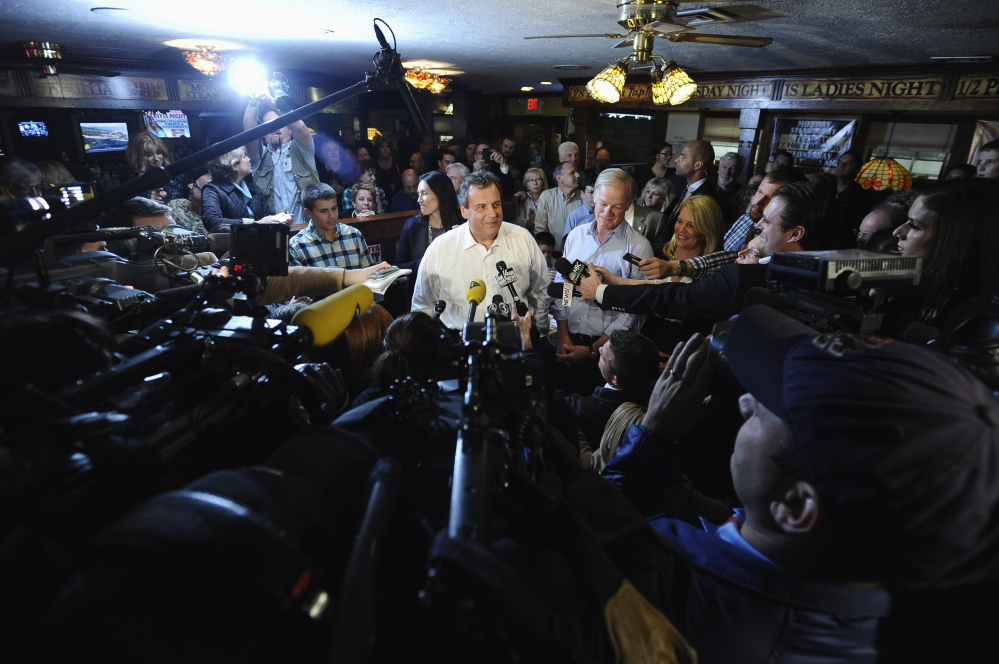 New Jersey Gov. Chris Christie answers questions from the media about nurse Kaci Hickox's quarantine as Republican candidate for Connecticut governor Tom Foley, right, listens, Monday, Oct. 27, 2014, in Groton, Conn. (AP Photo/Jessica Hill)