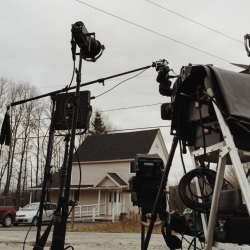 CBS news correspondent Don Dahler records a report Friday morning outside the home of Ted Wilbur, where Kaci Hickox is staying in Fort Kent. Whitney Hayward/Staff Photographer
