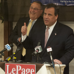 """Maine Gov. Paul LePage listens as New Jersey Gov. Chris Christie gives a campaign speech for him during a rally at the Bangor Banquet and Conference Center on Tuesday. Christie told more than 200 supporters, """"Paul LePage governs from the heart."""""""