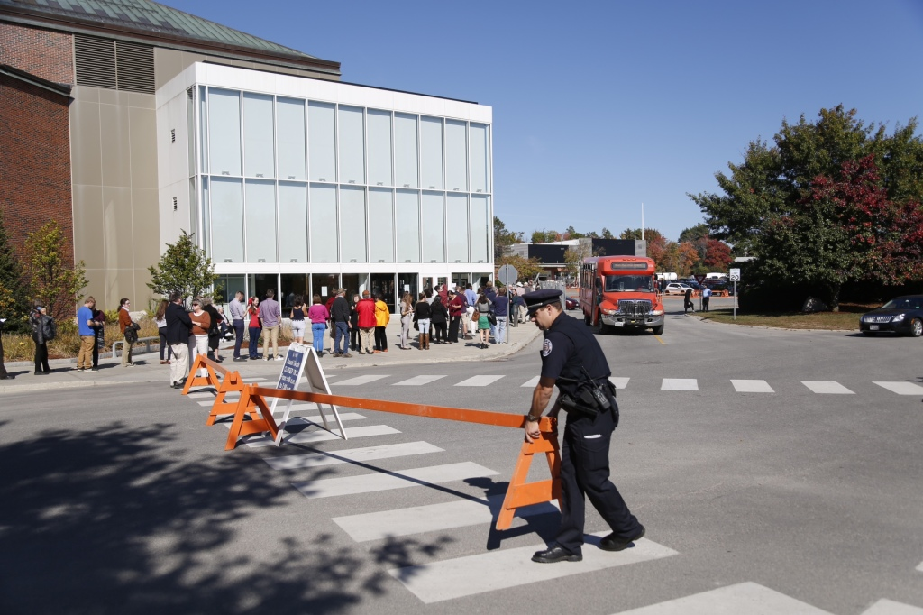 Police set up barricades as people wait in line outside the Collins Center for the Arts at the University of Maine in Orono to see First Lady Michelle Obama speak in support of Democratic candidate for governor, U.S. Rep. Mike Michaud, on Friday.