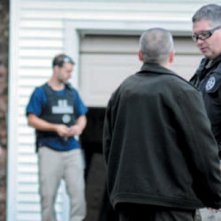 In this Nov. 2012 file photo, U.S. Marshals Service investigators search the residence of Barbara Cameron, the ex-wife of James Cameron, in Hallowell. Authorities spent more than two weeks looking for Cameron in 2012 after he cut off his electronic monitoring bracelet and drove to New Mexico before being captured. Maine's former top drug prosecutor fled the state after learning his appeal of child pornography convictions had failed.