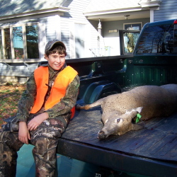 Cameron Couture, 11, of Wilton, shows off his first deer, a 138-pound doe he shot in Leeds last Saturday on Youth Hunting Day. Deer season for the rest of the state's residents opens today.