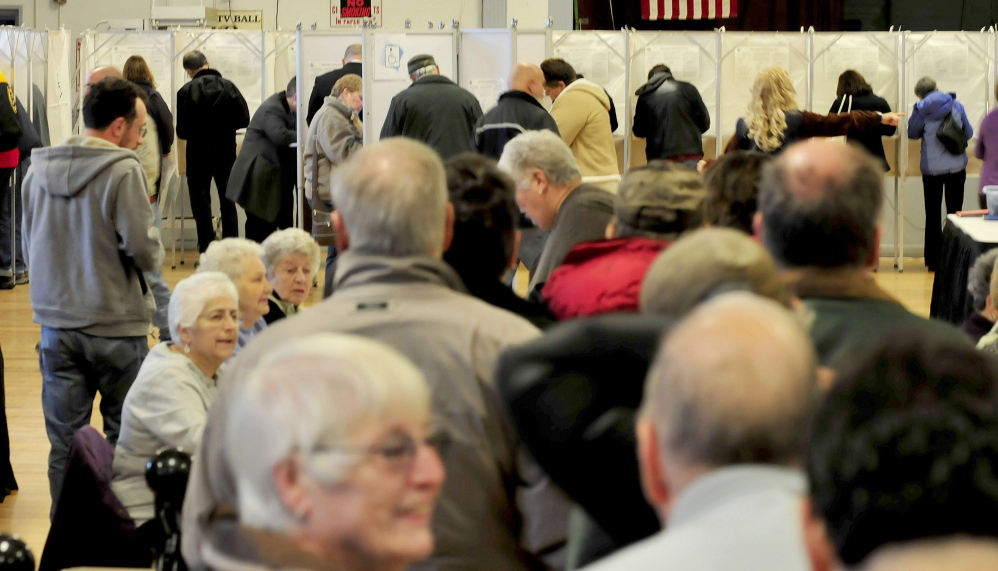 Waterville voters wait in line as others cast ballots ...