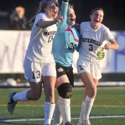 Waterville Senior High School goalie Gabrielle Martin, center, celebrates with teammates Morgann Tortorella, left, and Brooke Ettinger after they defeated Hermonl 1-0 in the Eastern Class B championship game Wednesday at Thomas College in Waterville.