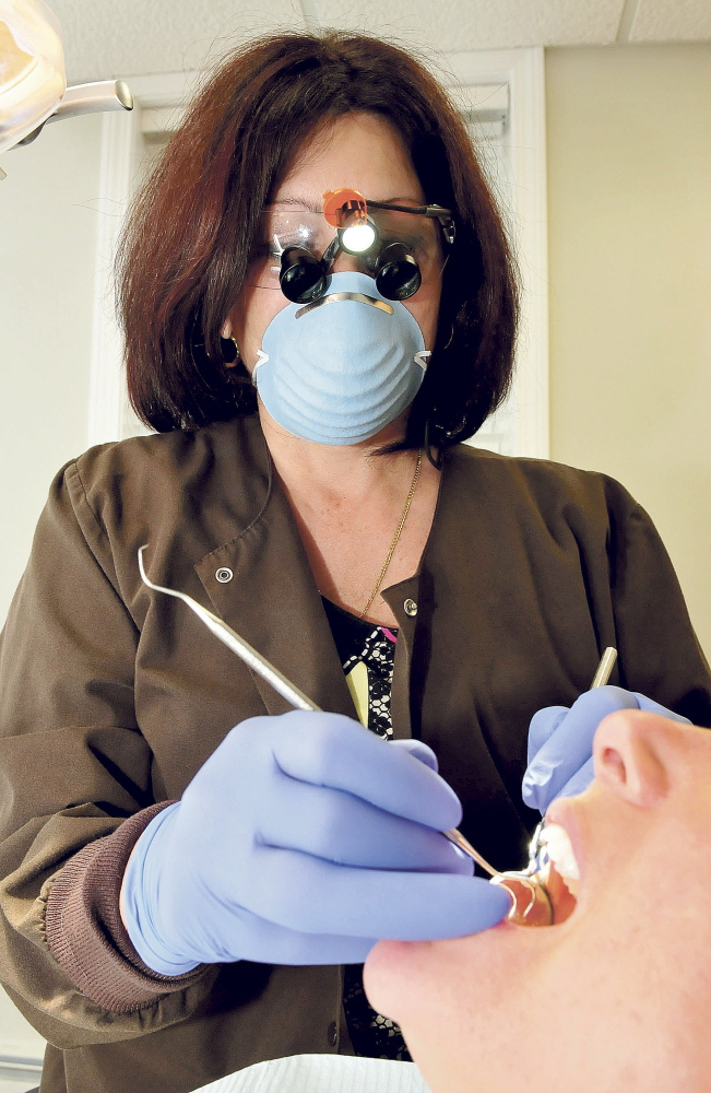 Demi Kouzounas, a dentist and co-founder of Dentists Who Care for ME, will offer free dental exams and treatment for people without dental insurance at Northwoods Dental practice in Skowhegan on Friday.