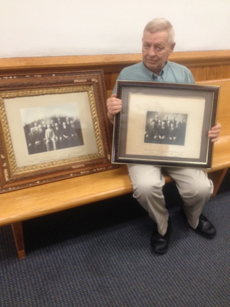 Somerset County Sheriff Barry Delong, who is retiring, holds up a photo from 1913 that he is donating to Somerset County commissioners.
