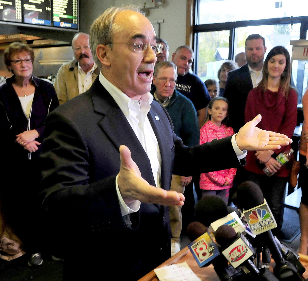 Bruce Poliquin outlines his plans Wednesday, a day after he was elected to Maine's 2nd District Congressional seat, during a news conference in Oakland.