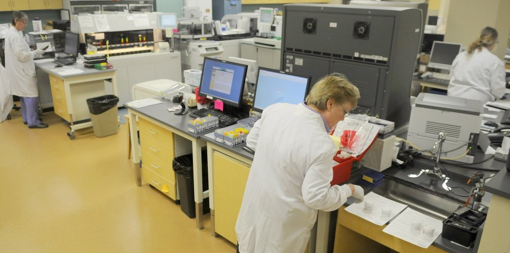 Technicians process samples recently in the laboratory at MaineGeneral.