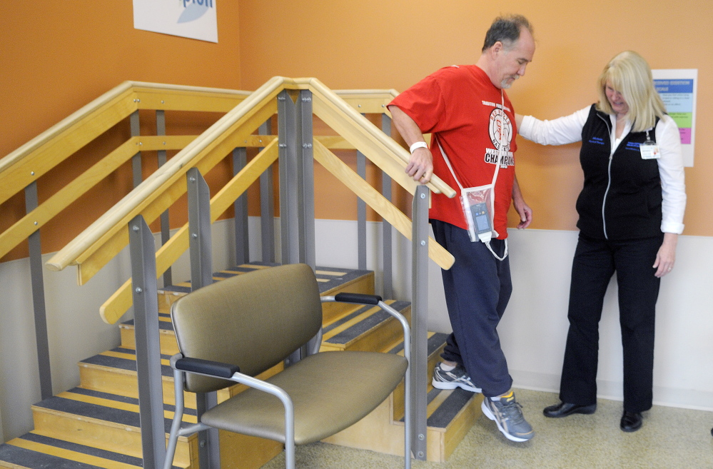 Jim Byrne practices steps with physical therapist Michele Walter in the long-term care and rehabilitation facility at MaineGeneral. The hospital will be celebrating its first anniversary in November. Byrne, of Winslow, is recovering from a stroke.