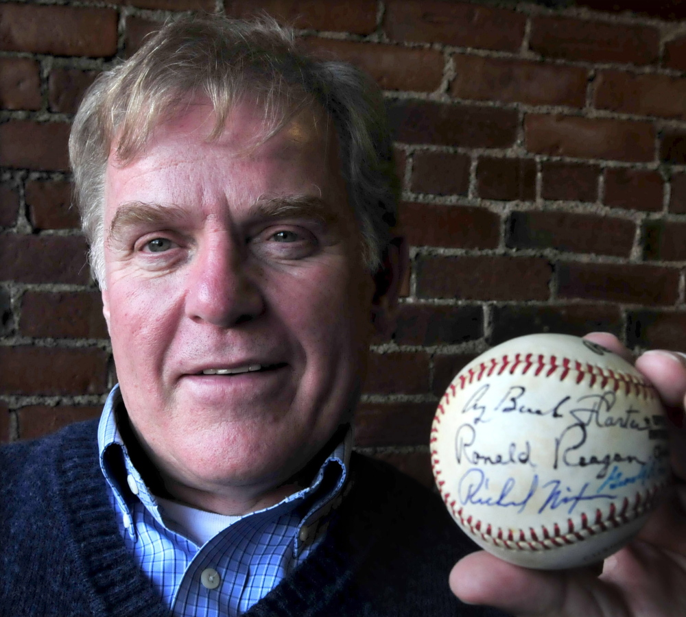 The Rev. Mark Tanner holds a baseball signed by seven U.S. presidents, everyone from Richard Nixon through Barack Obama, with the exception of George W. Bush.