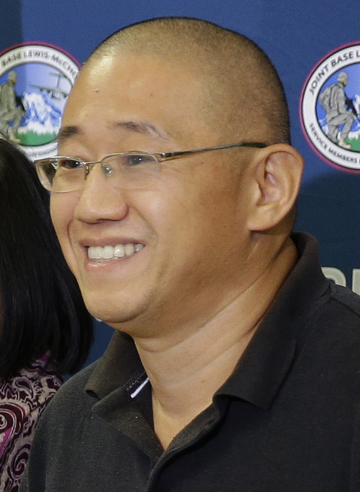 Kenneth Bae, left, and Matthew Miller arrived late Saturday at Joint Base Lewis-McChord in Washington state.