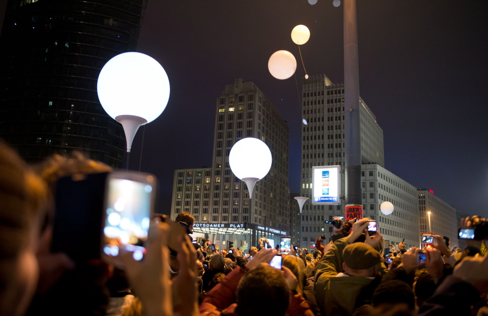 Balloons fly away at Potsdamer Platz in the center of Berlin on Sunday to commemorate the fall of the Berlin Wall in Germany 25 years ago on Nov. 9, 1989.
