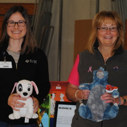Karen Hawkes, SVH Director of Occupational and Community Health, left, and Terri Vieira, SVH President/CEO and EMHS Senior Vice President stand with Kohl's Cares merchandise during the SVH Community Health Fair held in Pittsfield. Kohls donated the items for the fair.
