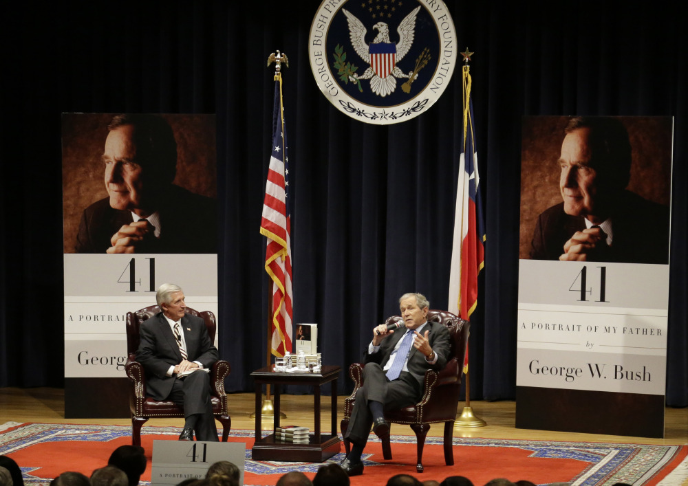 Bush, right,  discusses his new book with Andrew Card, his former chief of staff.