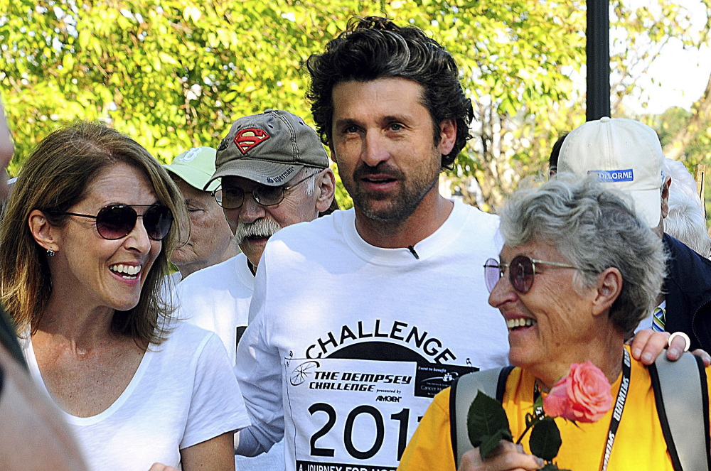 Actor Patrick Dempsey, center, prepares to start the Survivor Walk with his mother, Amanda, right, and Amgen Breakaway from Cancer Award winner Laura Davis on Oct. 8, 2011, in Lewiston on the first day of the Dempsey Challenge. The sixth Dempsey Challenge took place in September without the woman who provided the inspiration for the fundraiser and a cancer center. Amanda Dempsey died in March.